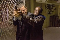 Guy Pearce and Don Cheadle tussle in Traitor
