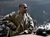 Photo of a scruffy Denzel Washington in the wasteland of Book of Eli