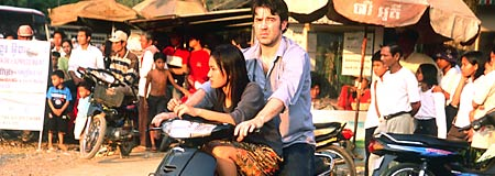 Ron Livingston and Thuy Nguyen in Holly