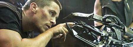 Christian Bale examines the work of the Machines in Terminator Salvation