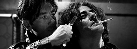 Clive Owen and Benicio Del Toro in Sin City