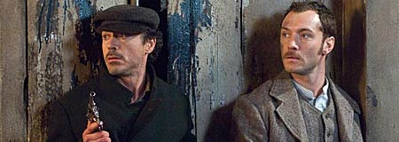 Robert Downey Jr. as Sherlock Holmes and Jude Law as Watson