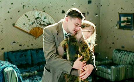 Leonardo DiCaprio and Michele Williams have a moment in Shutter Island