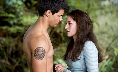 Taylor Lautner as Jacob and Kristen Stewart as Bella Swan in The Twilight Saga: New Moon