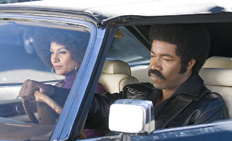 Salli Richardson-Whitfield and Michael Jai White in Black Dynamite