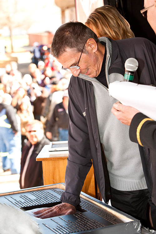 """CBS officially licensed Vulcan, Alberta as the first Star Trek capitol in the world and to commemorate this event and celebrate his retirement, Leonard Nimoy leaves behind his iconic """"live long and prosper"""" handprint. (Photo credit Glacier Valley Photography)"""