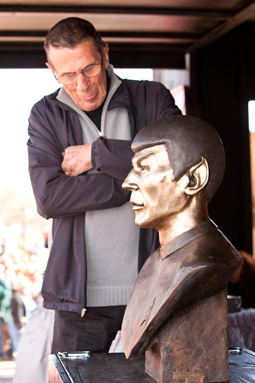 CBS officially licensed Vulcan, Alberta as the first Star Trek capitol in the world and to commemorate the event and celebrate his retirement, Leonard Nimoy admires the bronze bust of himself as Mr. Spock Friday afternoon in Vulcan. (Photo credit Glacier Valley Photography)