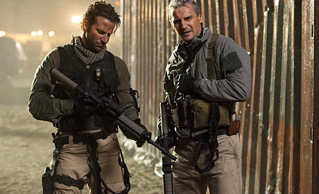 Bradley Cooper as Lt. Templeton Faceman Peck and Liam Neeson Col. John Hannibal Smith in The A-Team