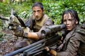 Royce (Adrien Brody) and Isabelle (Alice Braga) take aim during their desperate battle against the alien Predators.