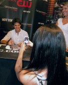 The Vampire Diaries star Steven R. McQueen poses for a fan photo during the signing.
