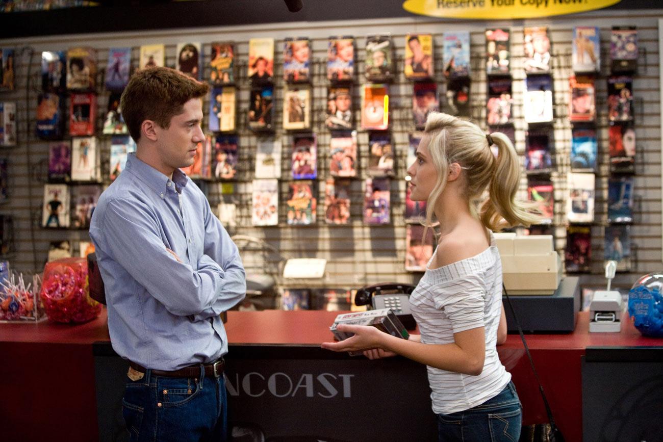 Matt (Topher Grace) and Tori (Teresa Palmer) meet again for the first time since high school in Suncoast Video. Photo Credit: Ron Batzdorff