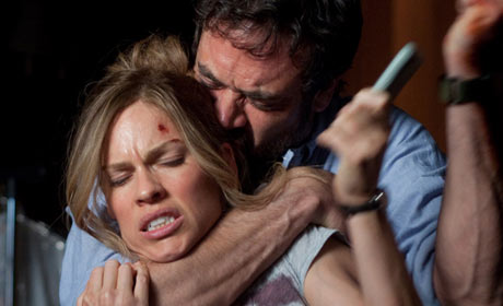 Jeffrey Dean Morgan and Hilary Swank tussle in The Resident