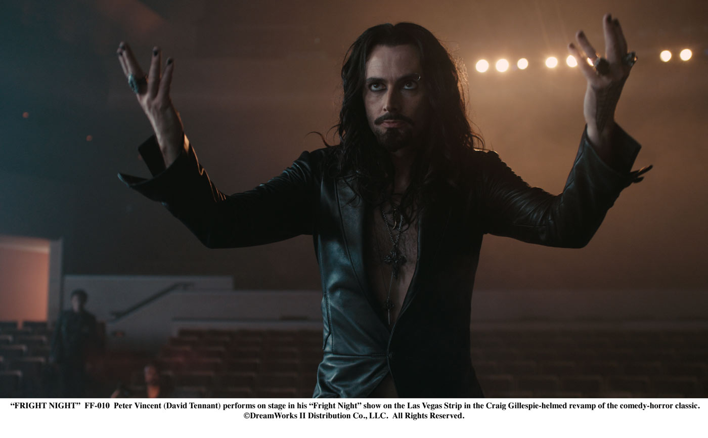 Peter Vincent (David Tennant) performs on stage in his Fright Night show on the Las Vegas Strip in the Craig Gillespie-helmed revamp of the comedy-horror classic.