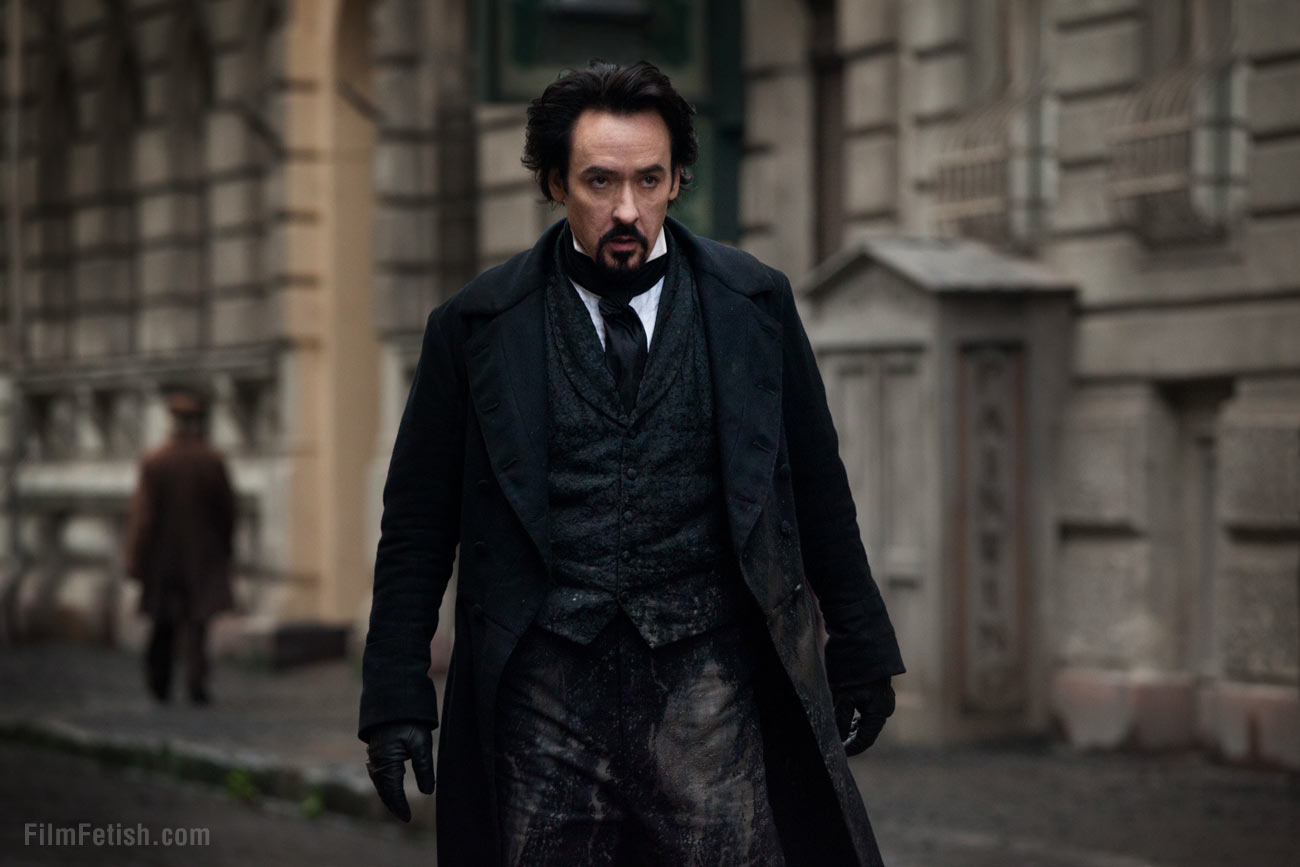 John Cusack as the tormented Edgar Allen Poe in The Raven