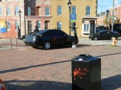 """In honor of the 162nd anniversary of Edgar Allan Poe's death today, October 7, 2011, and in support the upcoming release of Relativity Media's THE RAVEN on March 9, 2012, black-wrapped cars, mannequins, and trash cans with """"RIP EAP"""" emblazoned on them appeared in the Fells Point section of Baltimore, Maryland."""