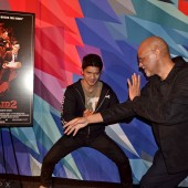 A director, a martial arts star, and a hammer-wielding assassin attend advanced screening of The Raid 2