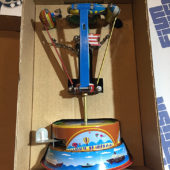 Rocket Ride Chain Carousel Lever Action Tin Collector Toy